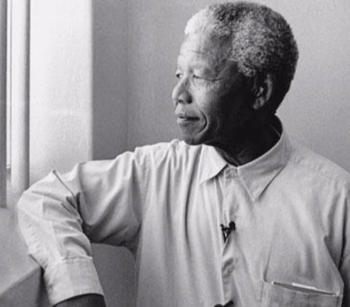 Nelson Mandela looking out of prison cell